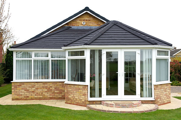 P-Shaped Conservatory with Equinox tiled solid roof in anthracite grey colour