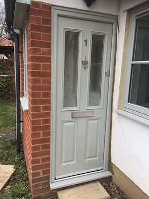 Agate grey composite front entrance door with silver knocker and letter box