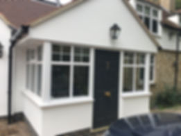 Solidor black composite door with gold coloured hardware