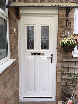 White composite front entrance door with two top decorative glass panels
