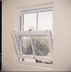 Vertical sliding sash window with single tilt inward sash