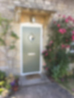 Cottage style composite entrance door in light green colourClanfield