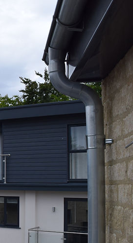 Galvanised rainwater goods with antracite grey fascia and soffits