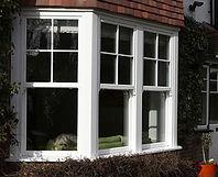 White uPVC (plastic) Bay Window with vertical sliding sashes