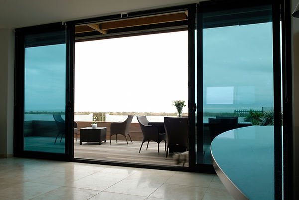 anthracite grey four part uPVC sliding patio doors with the outside tracker