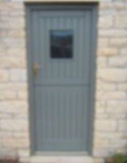 Stable front door in grey colour with Cockapoo