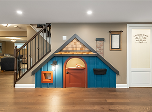 Kids basement playroom under the stairs
