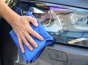 Man-polishing-shiny-car-headlight_b.jpg