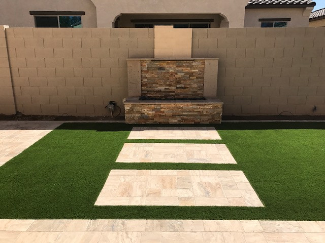 Modern Designs:  Travertine, Turf, and Waterfeature