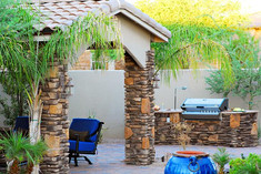 Stone Accented BBQ and Seating Area