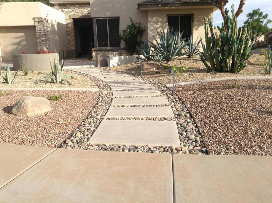 Pathway, Steel Edging, Concrete, River Rock, and 2 Tone Granite Areas