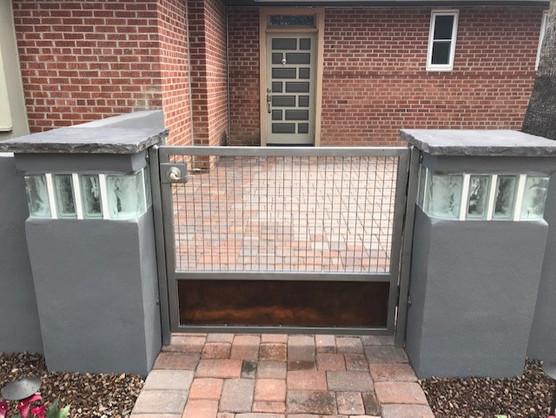 Custom Built Metal Gates and Modern Pillars with Glass and Lighting