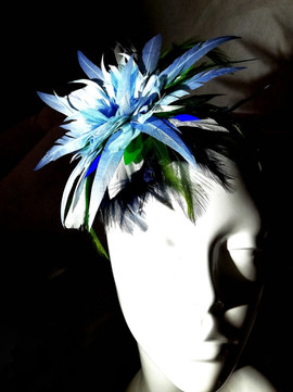 Blue feather fascinator Vandalised with Love