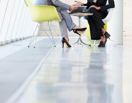 Two Businesswomen Meeting Around Table I