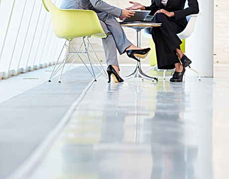 Two Businesswomen Meeting Around Table I