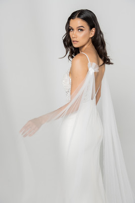 Tulle Wings elevate this beautiful crepe and lace wedding dress
