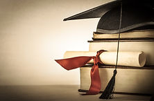 A mortarboard and graduation scroll, tie