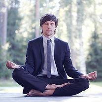 Businessman in suit practicing yoga in p