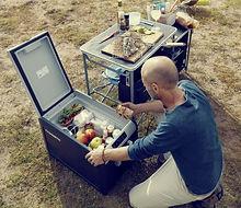 Man on knee in fridge CFX35.JPG