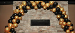 gold & black balloon arch