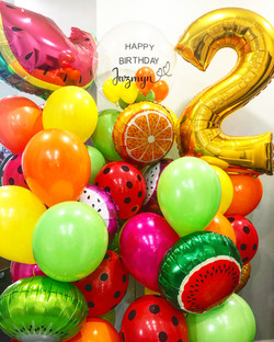 fruit themed balloons with personalized balloon and number