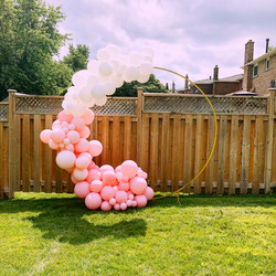 half balloon arch with gold backrop