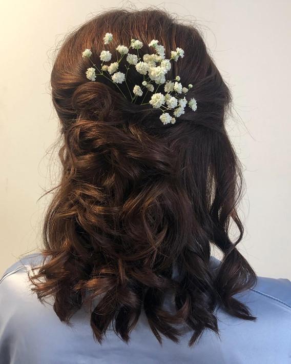 wedding curls with flowers.jpg