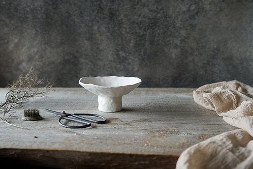 White bowl with leg