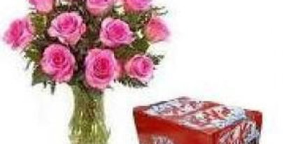 12 Pink Roses with a box of KitKat