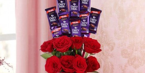 Red Roses with gyps Bouquet and Cadbury Dairy Milk Silk