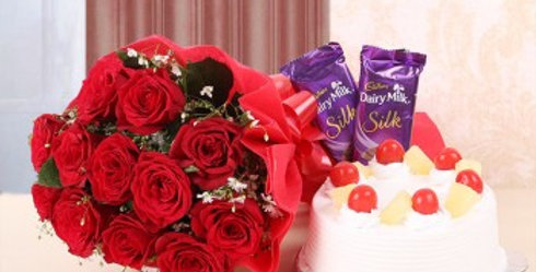 Red Rose Bouquet, Dairy Milk Silk and Vanilla Pineapple Cake Combo