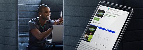 young-man-using-his-smartphone-at-his-workstation-screenshot-mockup.png