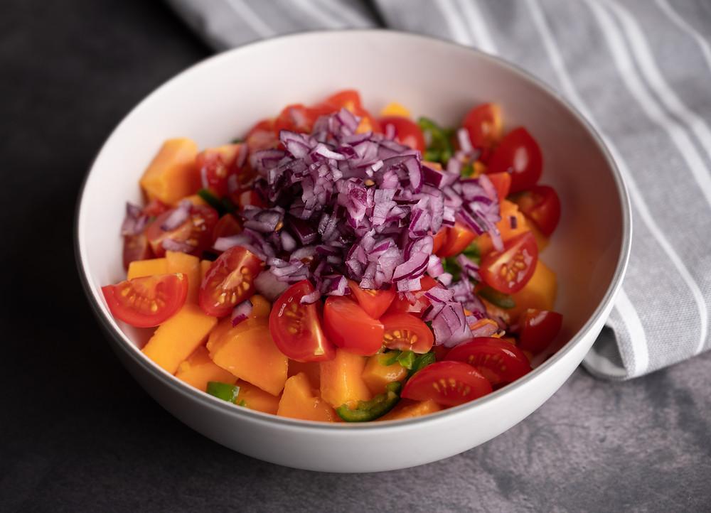 Papaya Salsa ingredients in the bowl