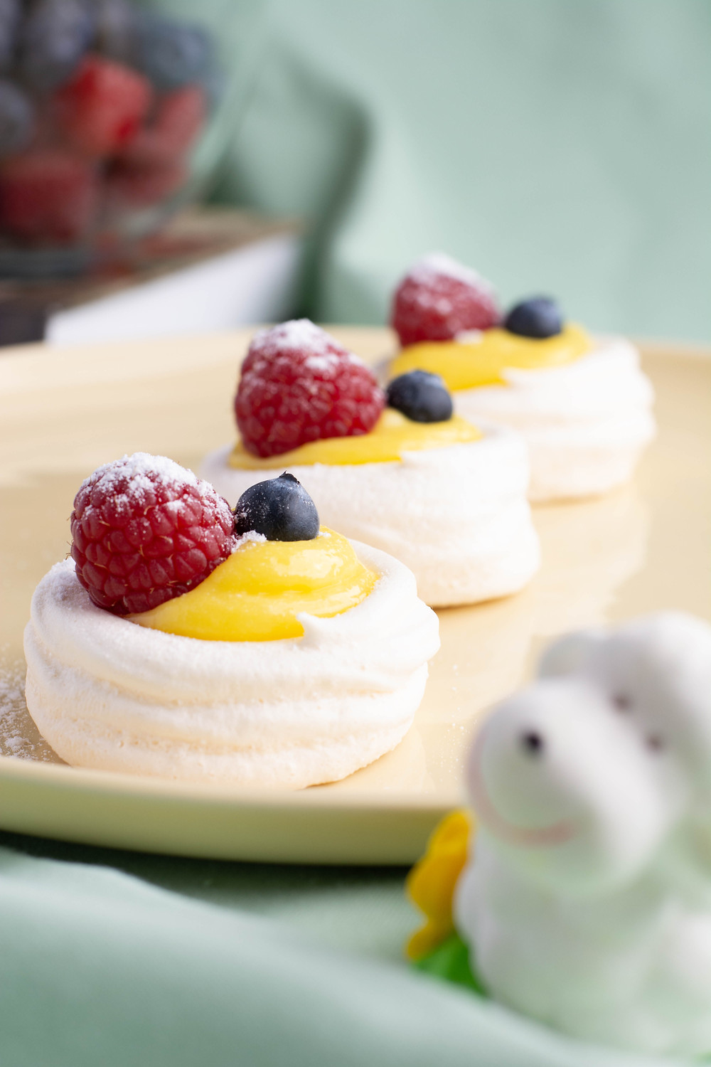 Meringue Nests with Lemon Curd and Berries on the plate