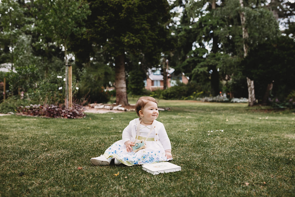1 year old girl sitting in a park, Watford, Hertfordshire