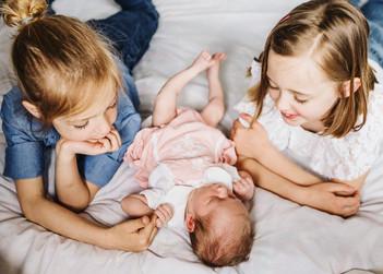 newborn photo with siblings.jpg