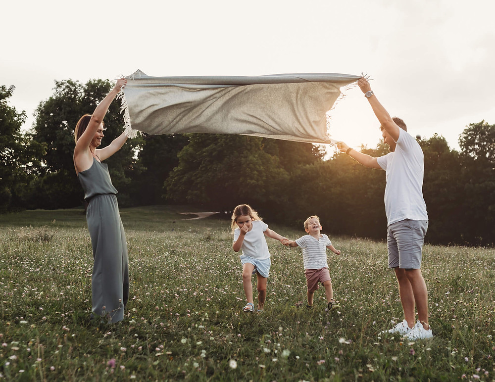 Family of four playing outdoor, Hertfordshire