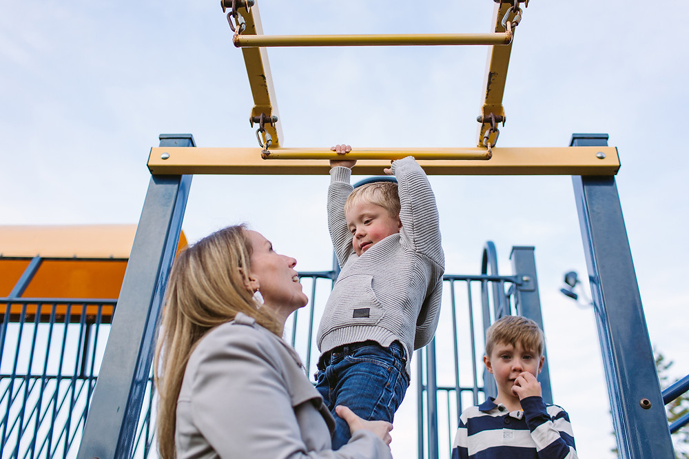 Kids and mom playing at playground at lake summerside