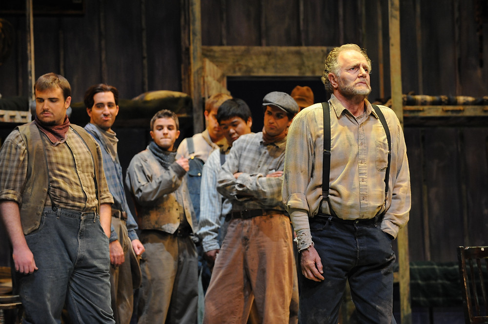 Slim (Steven Mumbert) and Candy (Stephen West) with the chorus 'Of Mice and Men.' Photo by Ellen Appel.