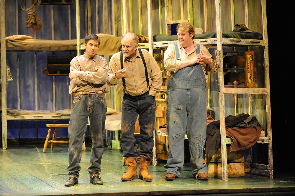 Phillip Addis as George, Stephen West as Candy, and Anthony Dean Griffey as Lennie. Photo by Ellen Appel.