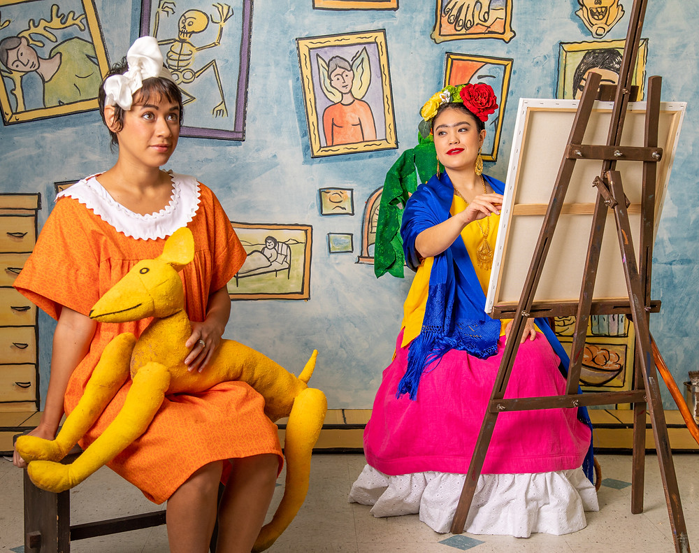 (Left to Right) Mariana (Soprano Robin Steitz) sits for a portrait with the great Mexican artist Frida Kahlo (Mezzo-Soprano Kayla Nanto) in Fort Worth Opera's Frida Kahlo and the Bravest Girl in the World. Photo by Timothy Walker Jr.