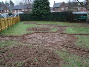 Rain, mud, wheelbarrows and tyre chippings…..