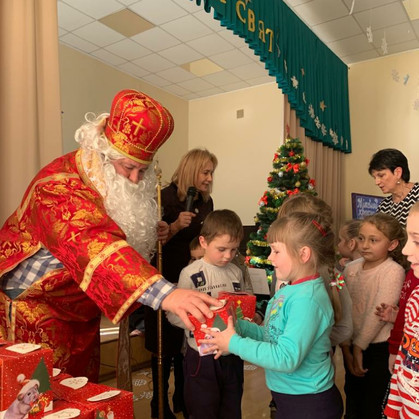 Village of students celebrating a visit from St. Nicholas