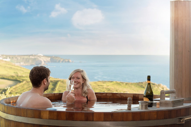 Relax in the hot tub at Hendra Cottage