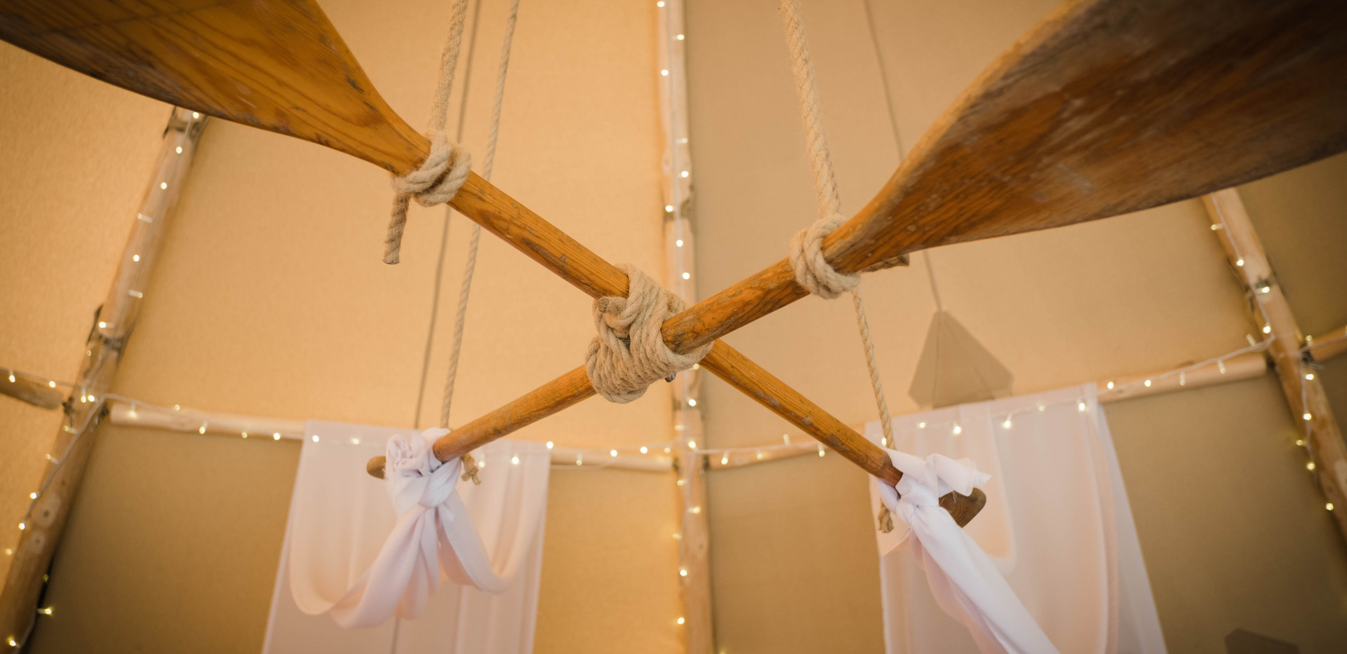 Oars and sails adorning a Wild Tipi