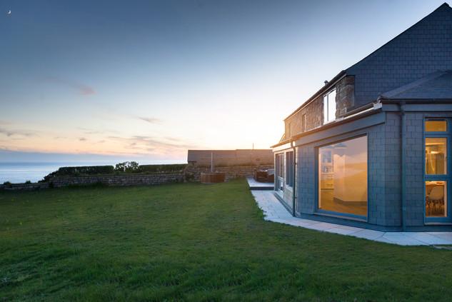22. House dusk with Atlantic views