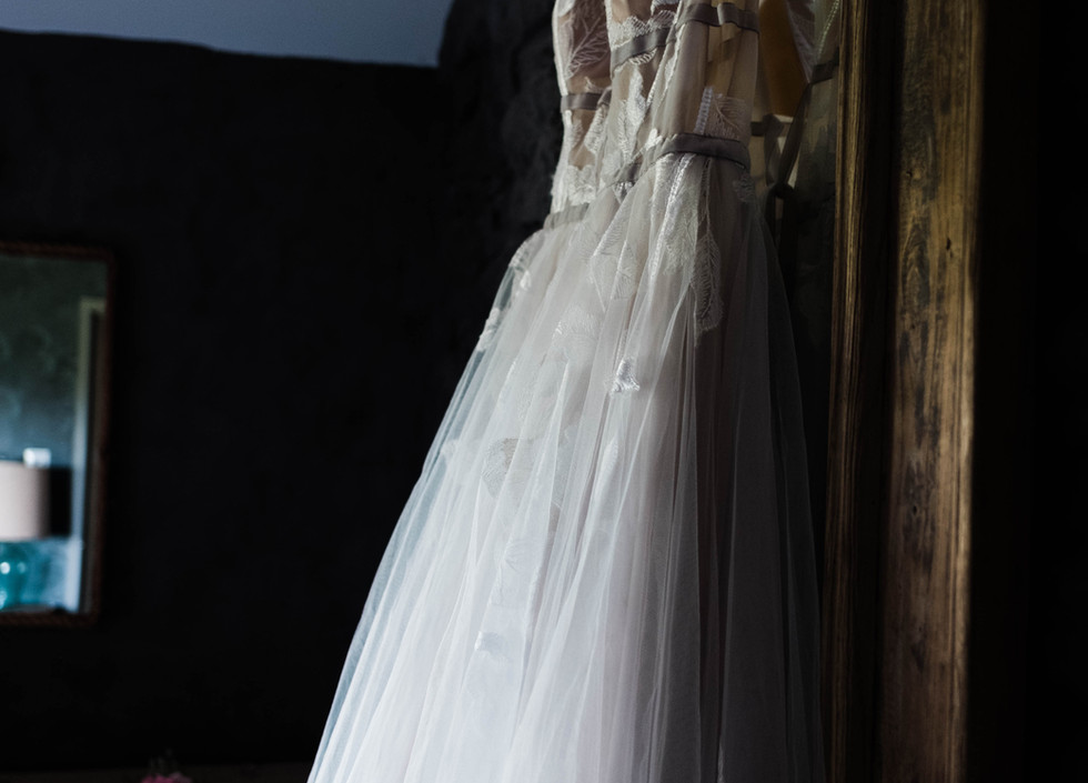 The dress hangs waiting to be worn...