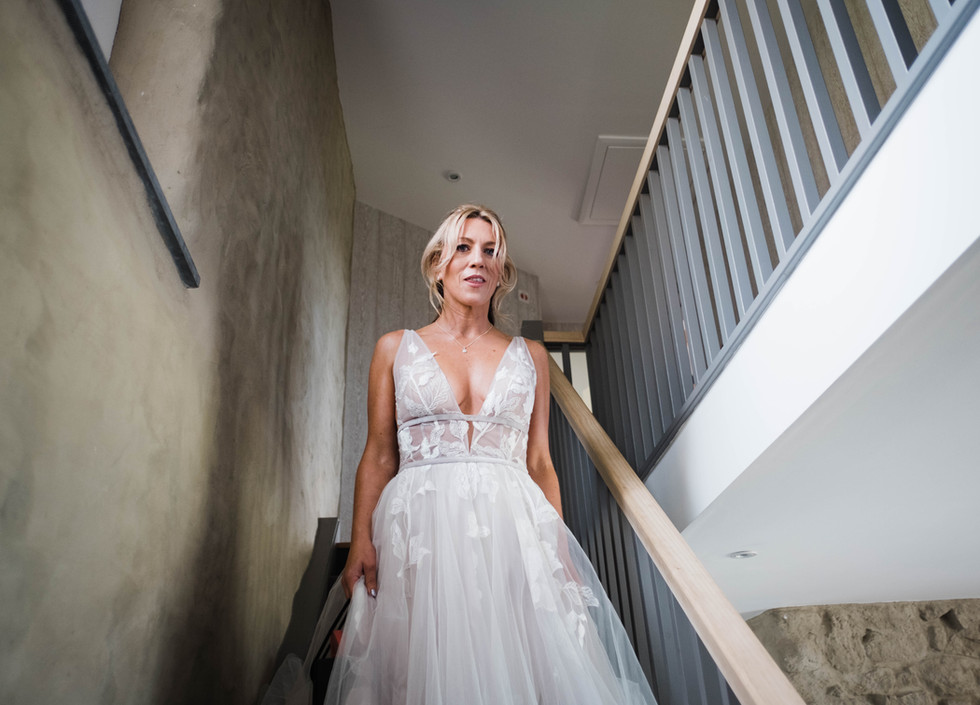 The bride descends the stairs at Hendra.