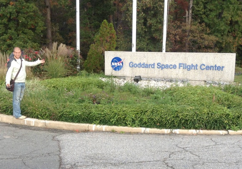 Andrei stands in front of the NASA Goddard Space Flight Center sign