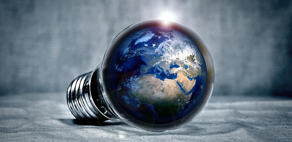 The globe sits inside a light bulb